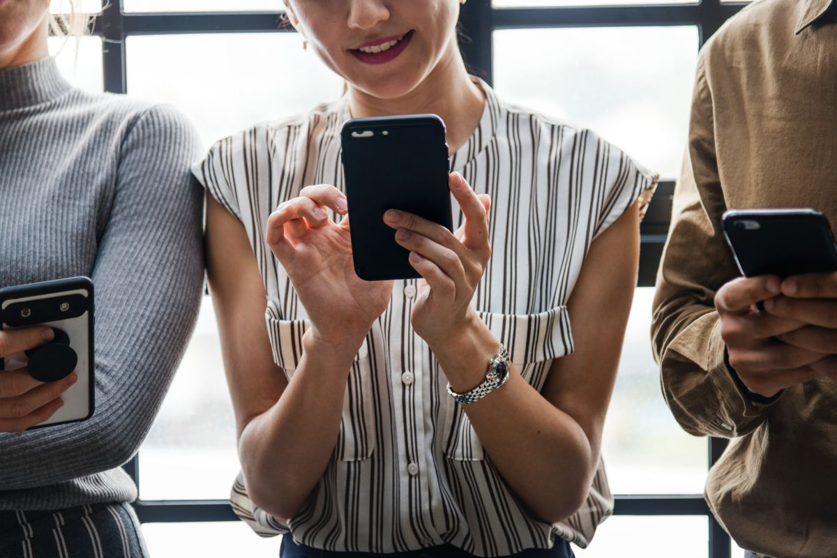 Woman with smartphone looking happy